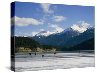 Hockey on Frozen Green Lake in Whistler, British Columbia, Canada
