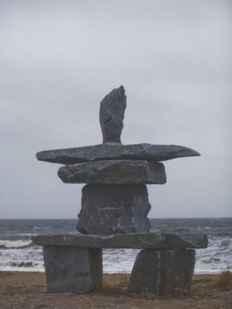 Stone Inukshuk Stands at the Edge of Hudson's Bay