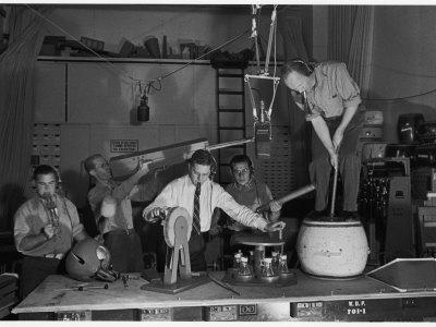 https://imgc.artprintimages.com/img/print/technicians-in-sound-production-room-at-walt-disney-studio-using-hanging-mikes-and-handheld-boom_u-l-p43jw00.jpg?p=0