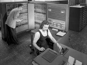 Technicians with Room Size IBM Type 704 Computer Making Calculations for Aeronautical Research