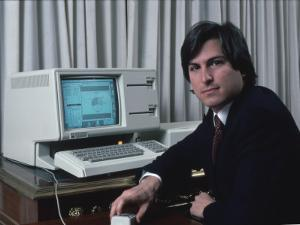 Apple Computer Chrmn. Steve Jobs with New Lisa Computer During Press Preview by Ted Thai