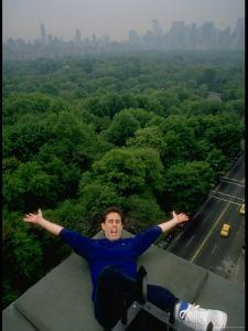 Comedian Jerry Seinfeld Perching Precariously on Roof Ledge Overlooking Central Park by Ted Thai