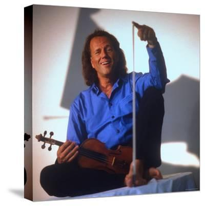 Dutch Violinist Andre Rieu Relaxing, Taking Practice Break with Violin