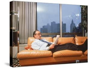 Fed. Reserve Bd. Chairman Appointee Alan Greenspan Stretched Out on Couch in His Apartment by Ted Thai