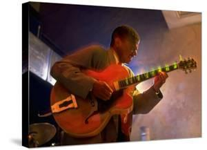 Guitarist Mark Whitfield Playing Large Guitar at MK's by Ted Thai