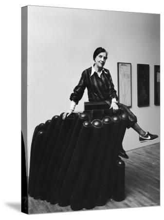 """Louise Bourgeois with Her Sculpture """"Femme Maison"""" at the Museum of Modern Art"""
