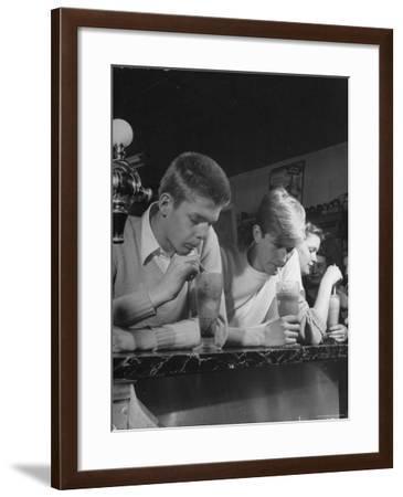 Teen Age Boys and Girls Drinking Milkshakes in Drug Store-Nina Leen-Framed Photographic Print