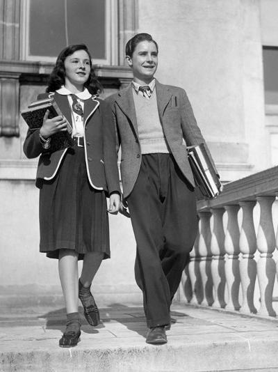 Teen Couple With Books Walking Outside School-George Marks-Photographic Print