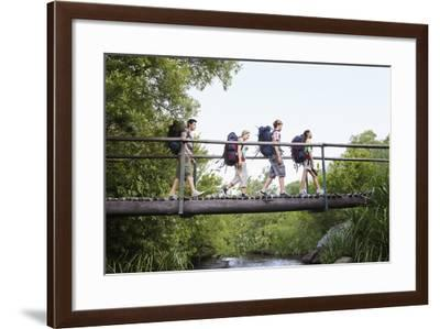 Teenage Boys and Girls with Backpacks Walking on Bridge in Forest-Nosnibor137-Framed Photographic Print