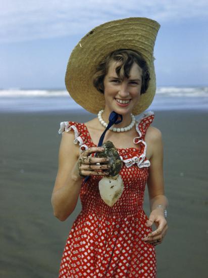 Teenage Girl Holds a Toheroa, a Marine Clam Native to New Zealand-Howell Walker-Photographic Print