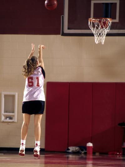 Teenage Girl Practicing Basketball Indoors--Photographic Print
