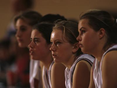 Teenage Girls Basketball Team Watching the Game from the Bench--Photographic Print
