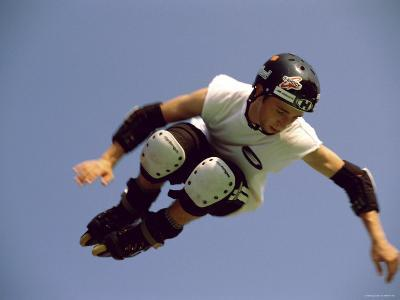 Teenager Inline Skating in Mid-Air--Photographic Print