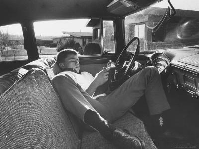 Teenager Robert Riesenmy Jr. Reading in Car at Home-Robert W^ Kelley-Photographic Print