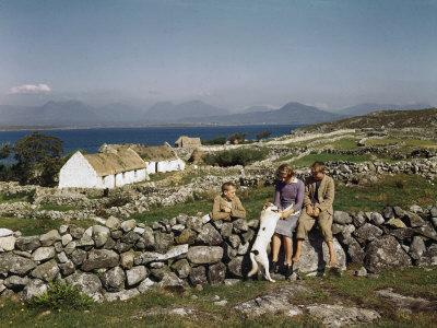 Teenagers Relax on a Stonewall Near their Home in Connemara-Howell Walker-Photographic Print