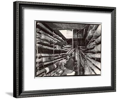 Telephone Repair Man Splicing a Wire in a Manhole for Telephone Cables of the New York Telephone Co-Margaret Bourke-White-Framed Premium Photographic Print