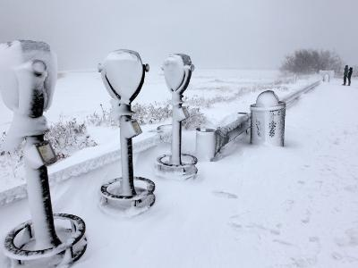 Telescope Viewers are Covered in Snow Overlooking Lighthouse Beach in Chatham, Massachusetts--Photographic Print
