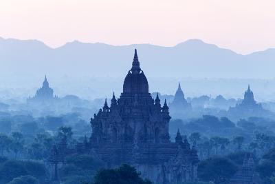 Temples and Pagodas in Early Morning Mist at Dawn, Bagan (Pagan), Myanmar (Burma)-Stephen Studd-Photographic Print