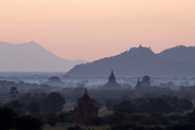Temples, Pagodas and Stupas in Early Morning Mist at Sunrise, Bagan (Pagan), Myanmar (Burma)-Stephen Studd-Photographic Print