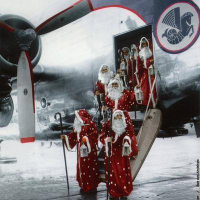 Ten Santa Claus Deplaning December 15, 1953. Colorized Document