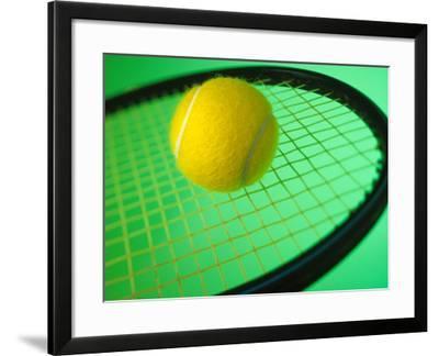Tennis Ball on Racquet--Framed Photographic Print