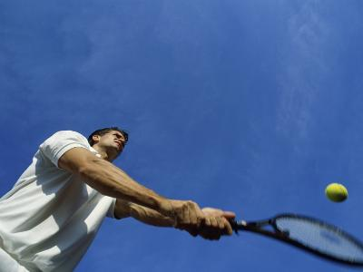 Tennis Player with Blue Sky--Photographic Print