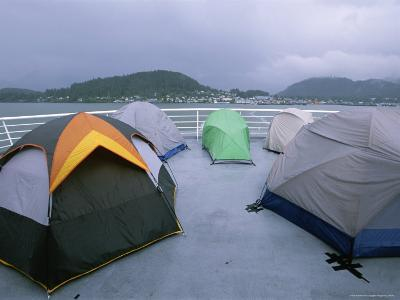 Tents Pitched by Campers on the Deck of a Ferry-Rich Reid-Photographic Print