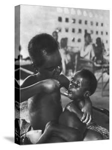 Biafran Child Feeding Another Child by Terence Spencer