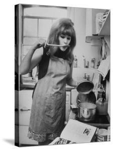 Lynn Redgrave Cooking in Her Apartment by Terence Spencer