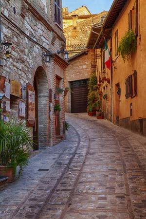 Colored Buildings and Stores Along a Back Street of Spello by Terry Eggers