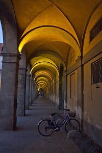 Evening and Lighted Arched Hallway, Lucca, Italy by Terry Eggers