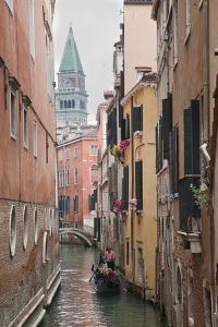 Gondoliers in Back Canal of Venice, Italy by Terry Eggers