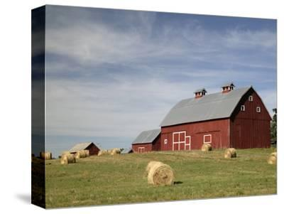 Hay Bales and Red Barn by Terry Eggers