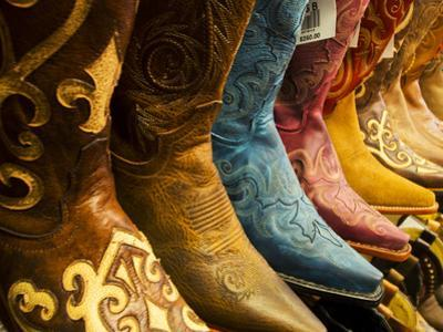 USA, Arizona, Old Scottsdale, Line Up of New Cowboy Boots by Terry Eggers
