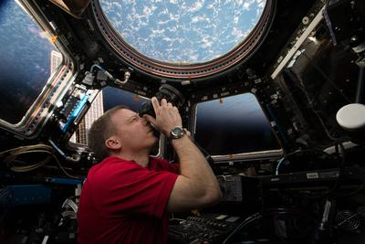 Astronaut Takes Photographs Through the Windows of the Cupola of the Iss