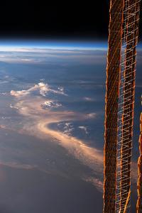 High Clouds are Partially Obscured by Part of the Exterior of the Iss by Terry Virts