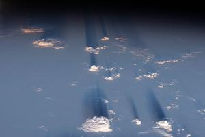 Late Afternoon Light Casts Long Shadows Beyond Amazon Rainforest Clouds by Terry Virts