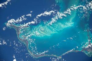 Ripples in the Sea Bed are Visible Beneath the Water of the Caribbean Ocean by Terry Virts