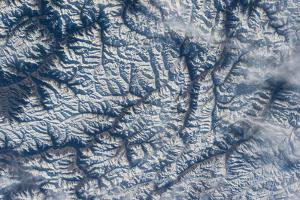 Snow-Covered Mountains in the Himalayas by Terry Virts