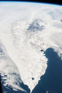 Snow Covers the Kamchatka Peninsula Between the Sea of Okhotsk and the Pacific Ocean by Terry Virts