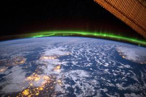 The Green Lights of the Aurora Borealis in the Distance Near Amchitka Island by Terry Virts