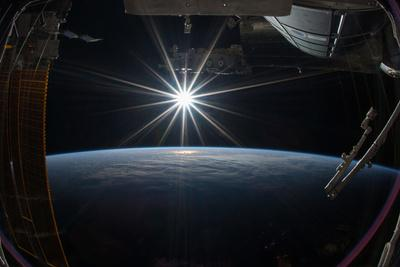 The Sun Rising over Earth from the Iss