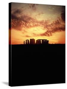 Sunset Behind Stonehenge, England by Terry Why