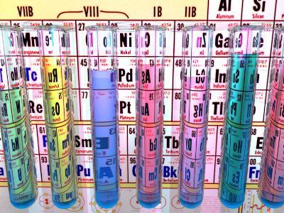 Test Tubes in Front of a Periodic Table-Carol & Mike Werner-Photographic Print