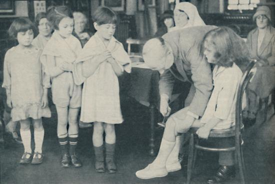' Testing the patella reflex for indication of nervous disease', c1935-Unknown-Photographic Print