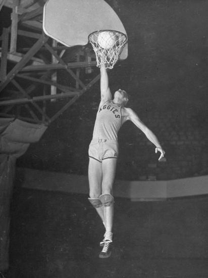 Texas A&M Basketball Player Bob Kurland Reaching to Make a Basket-Myron Davis-Photographic Print