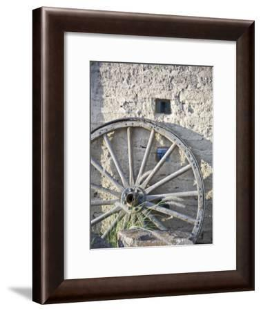 Texas, Western Themed Brewster County. Wagon Wheel Against White Washed Adobe Wall-Richard Nowitz-Framed Photographic Print