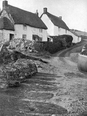 https://imgc.artprintimages.com/img/print/thatched-cottages-in-cadgwith-cornwall-1924-1926_u-l-ptwl1h0.jpg?p=0
