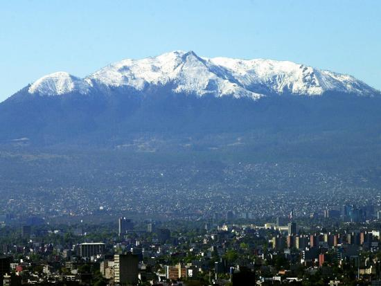 The Ajusco Mountain is Seen Behind Mexico City--Photographic Print