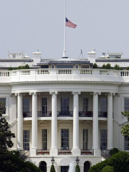The American Flag Flies at Half-staff Atop the White House-Stocktrek Images-Photographic Print